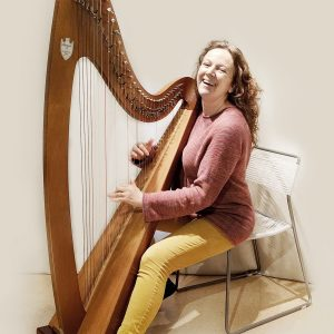 Mavis Dixon - Engagement Expert - Playing the harp